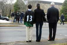 Mourners wait for the hearse of Nico Mallozzi, the 10-year old West School student who died of the flu Jan. 14, to leave St. Aloysius Church following the funeral service in New Canaan, Conn. on Monday, Jan. 22, 2018.