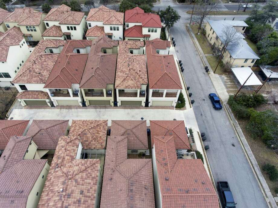 Newer, left, and original, right, housing stock can be seen Jan. 18 in the Westfort area of San Antonio. The rising cost of housing is not as attributable to regulations as some contend. Photo: William Luther /San Antonio Express-News / © 2018 San Antonio Express-News