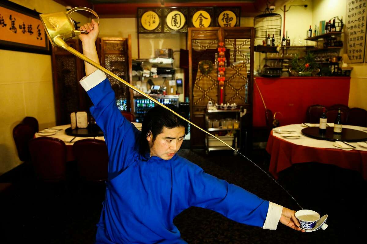 Xumin Liu pours tea while performing the ancient art of gongfu cha at Z & Y Restaurant in San Francisco.