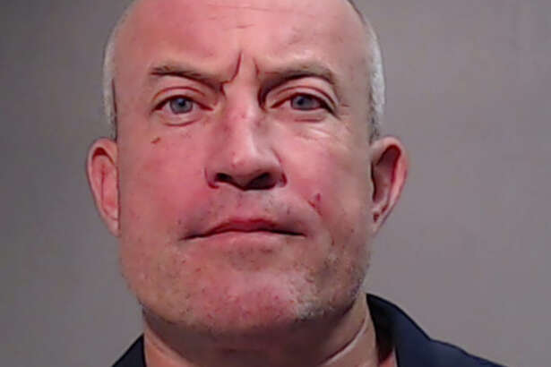 Former San Antonio-area football coach John Campbell was arrested and charged with driving while intoxicated Saturday in Edinburg.