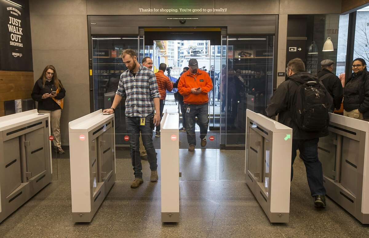 SEATTLE, WA - JANUARY 22: Shoppers enter and check out with purchases at the Amazon Go, on January 22, 2018 in Seattle, Washington. After more than a year in beta Amazon opened the cashier-less store to the public. (Photo by Stephen Brashear/Getty Images)
