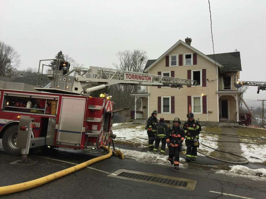 Crews extinguished a fire that broke out at at 102 Highland Ave. in Torrington Monday. Photo: Ben Lambert / Hearst Connecticut Media