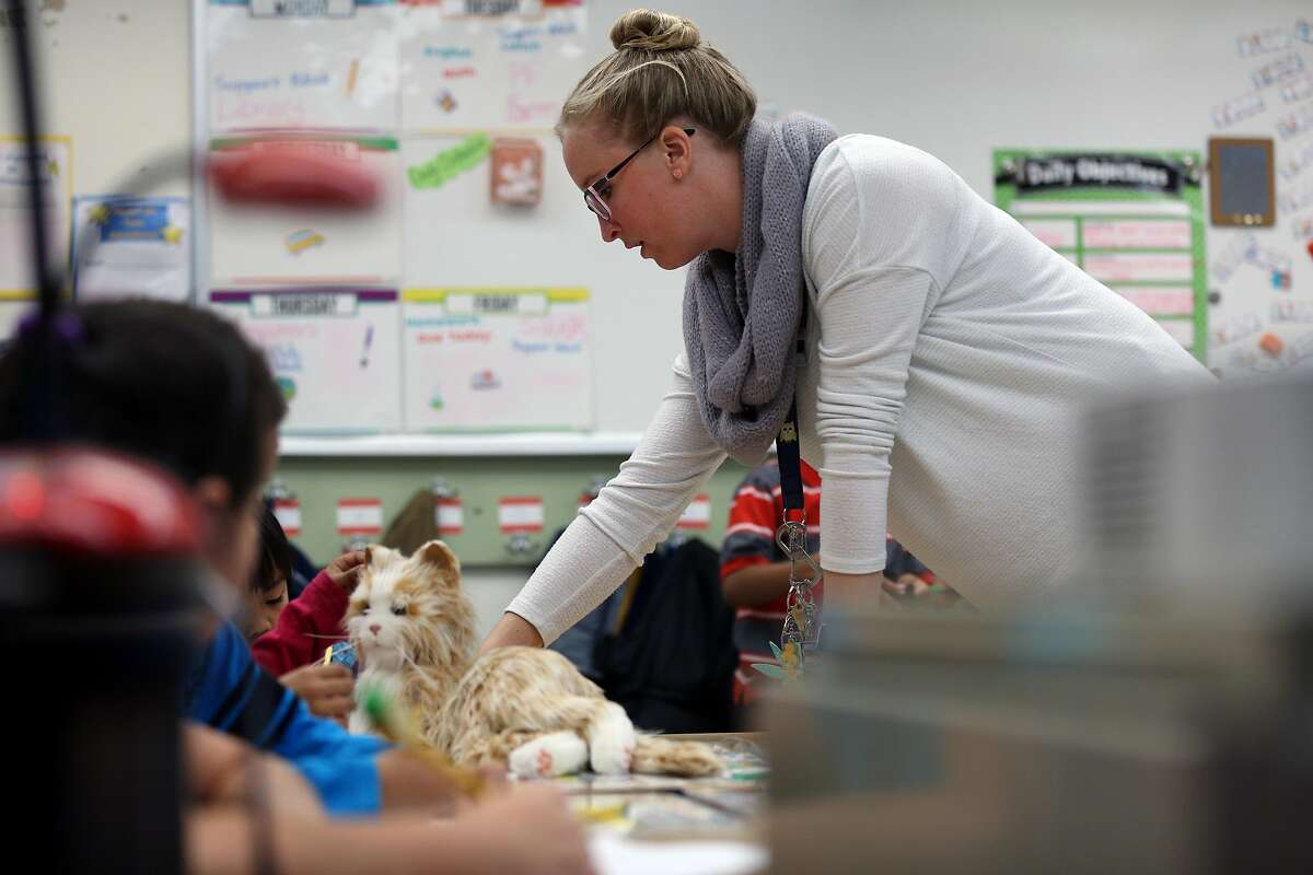 Sadie Leslie teaches and uses two robotic cats as comfort animals for her students at Loma Vista Elementary School, Friday, Jan. 12, 2018, in Vallejo, Calif.