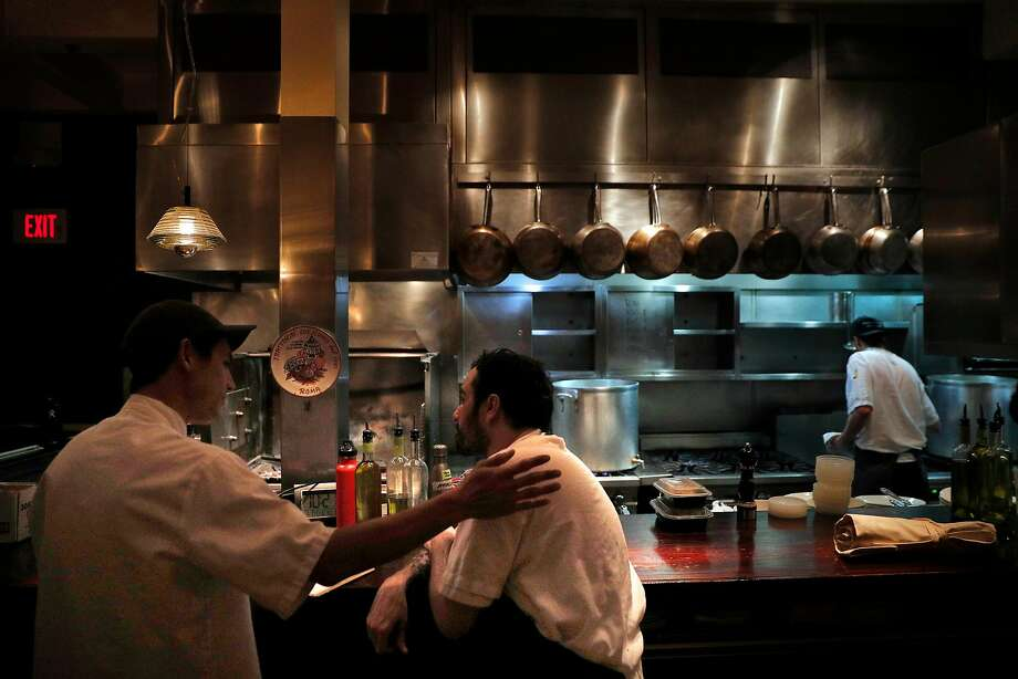 After the dinner shift at Locanda in S.F., sous chefs Bryan Hu (left) and Marco Inclan discuss the evening's work. Photo: Carlos Avila Gonzalez, The Chronicle