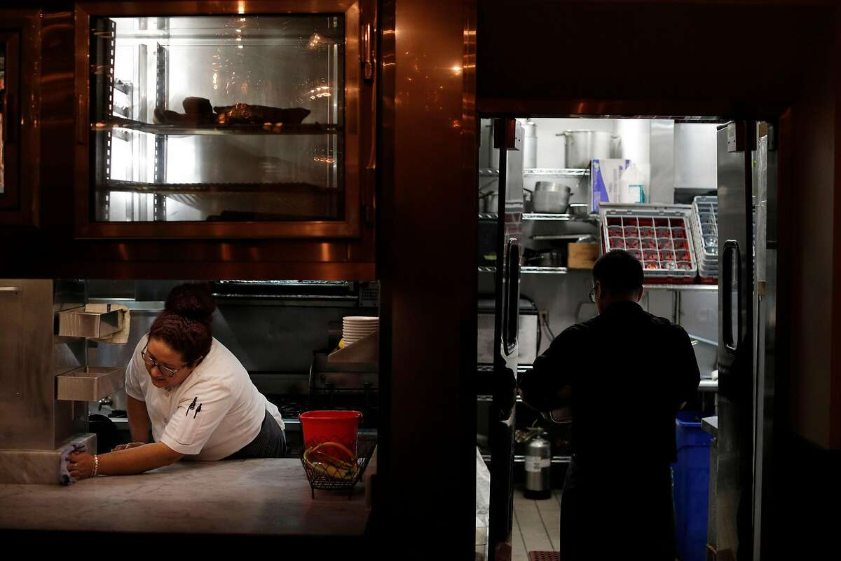 Cook Yeni Reyes cleans her work station as the crew cleans and preps for the next day after the dinner shift at Locanda in San Francisco, Calif., on Wednesday, January 17, 2018.