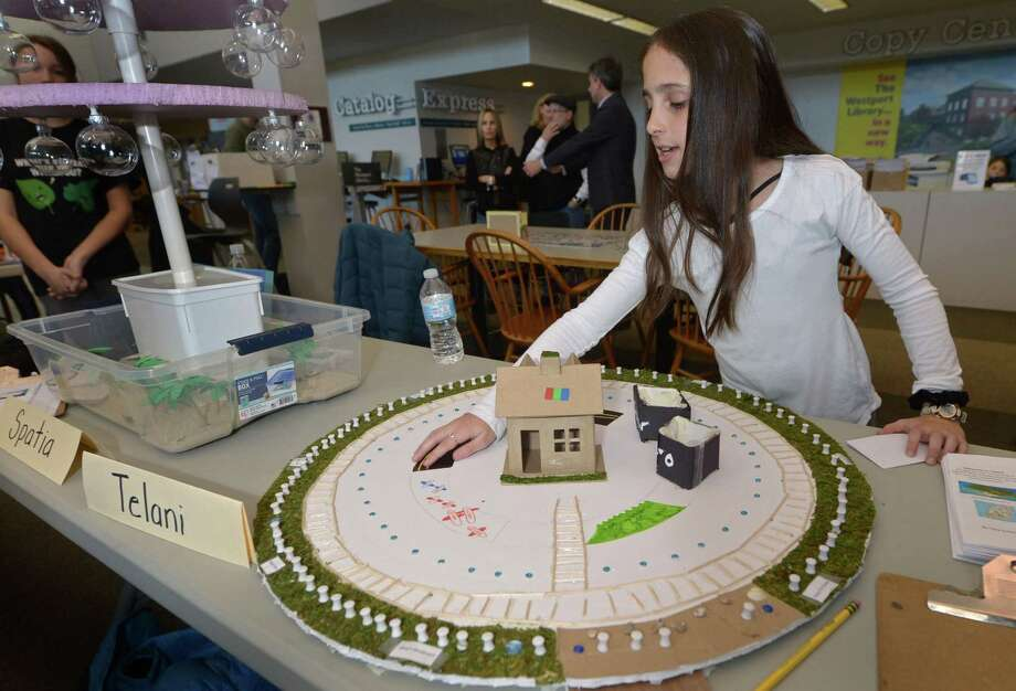 Coleytown Middle School 7th grader Toby Goldfarb describes her Utopia, Telani, as students from Coleytown and Bedford Middle School present their creative Utopia projects at the Westport Library Thursday, January 18, 2018, in Westport, Conn. For the Utopia Projects the students spent two months designing a unique and efficient ideal society and then select a geographic location, researched the natural resources of their selected location, and considered how to design a society that would sustain a population of 5,000 diverse individuals. Photo: Erik Trautmann / Hearst Connecticut Media / Norwalk Hour