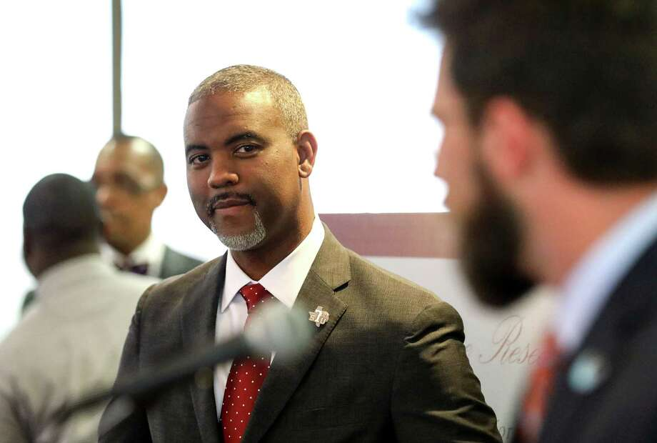 Austin Lane, president of Texas Southern University, listens as John Hardin, director of university relations for the Charles Koch Foundation, speaks during a press conference at Texas Southern University, Monday, Jan. 22, 2018, in Houston.The press conference celebrated a $2.7 million gift from the Center for Advancing Opportunity to Texas Southern University to start the Center for Justice Research. Photo: Jon Shapley, Houston Chronicle / © 2017 Houston Chronicle