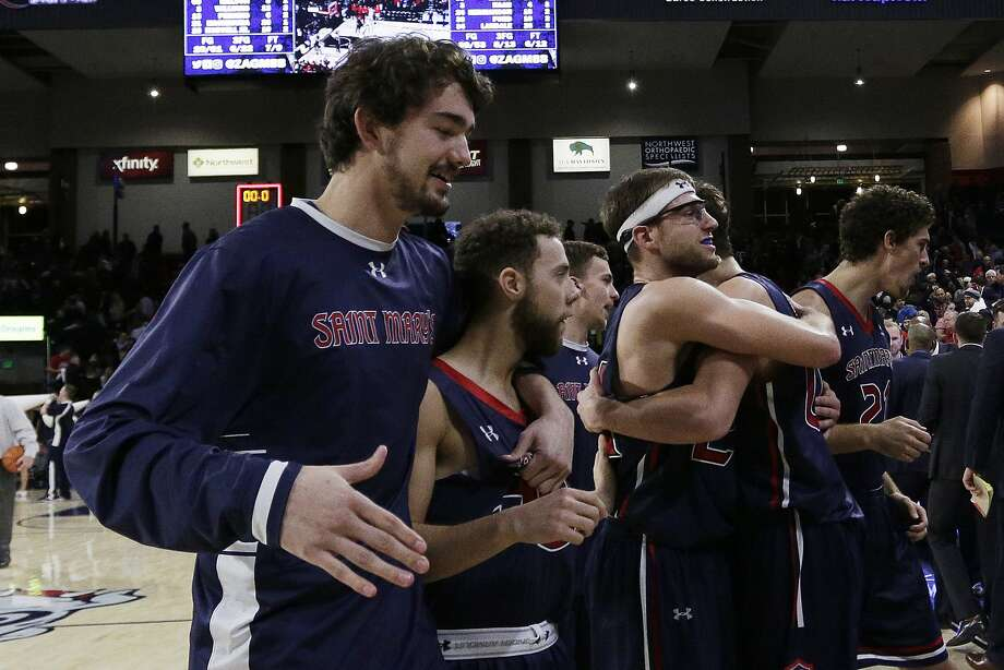 Saint Mary's players celebrate after a 74-71 win over Gonzaga in an NCAA college basketball game in Spokane, Wash., Thursday, Jan. 18, 2018. (AP Photo/Young Kwak) Photo: Young Kwak, Associated Press