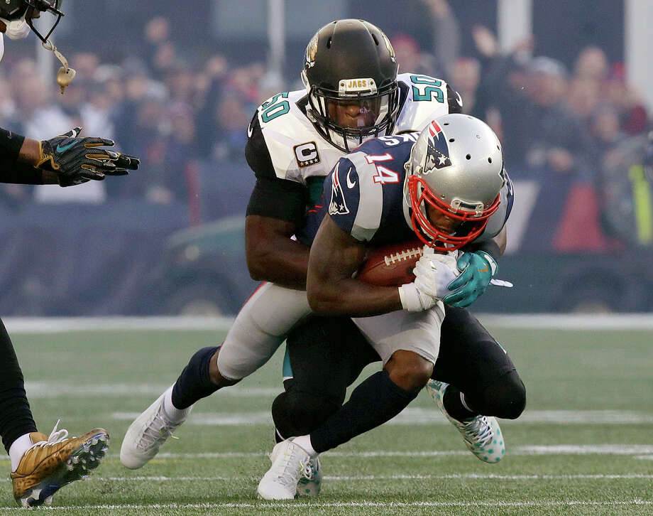 Jacksonville Jaguars linebacker Telvin Smith (50) tackles New England Patriots wide receiver Brandin Cooks (14) during the first half of the AFC championship NFL football game, Sunday, Jan. 21, 2018, in Foxborough, Mass. (AP Photo/Charles Krupa) Photo: Charles Krupa, Associated Press / Copyright 2018 The Associated Press. All rights reserved.
