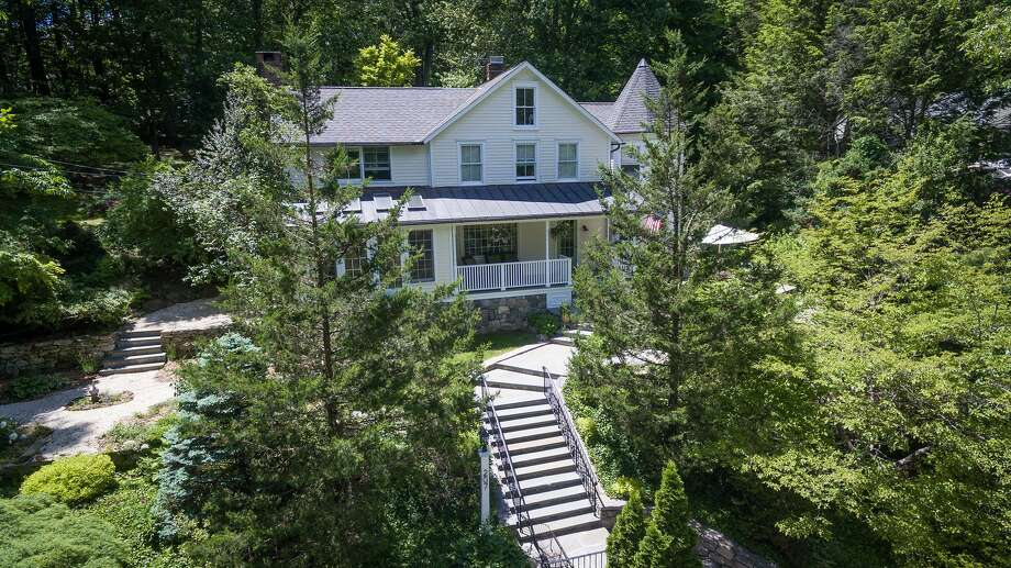 The antique colonial stone and clapboard house at 207 Mill Road was built in 1860 but has received many recent improvement including new mechanicals, roof, and kitchen upgrades. Photo: Contributed Photo / Hearst Connecticut Media / New Canaan News
