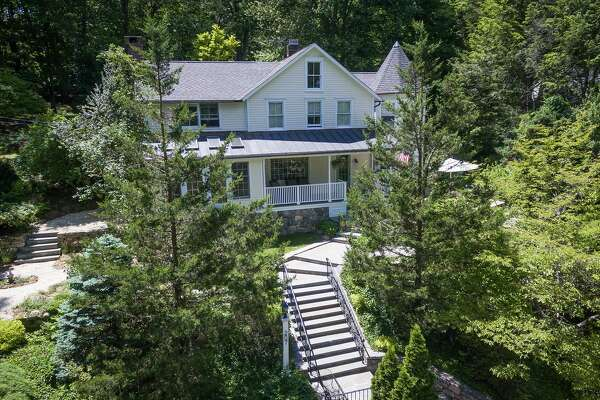 The antique colonial stone and clapboard house at 207 Mill Road was built in 1860 but has received many recent improvement including new mechanicals, roof, and kitchen upgrades.