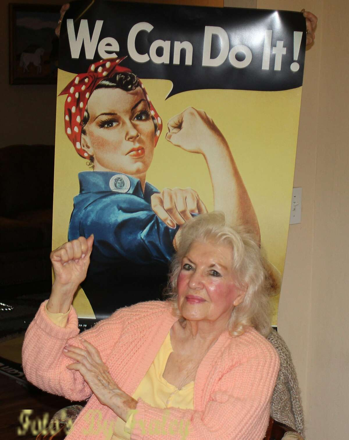 """In a photo provided by John D. Fraley, Naomi Parker Fraley in 2015 with the Rosie the Riveter poster that became a feminist touchstone. Fraley, who died on Jan. 20, 2018, at age 96 in Longview, Wash., went unsung for seven decades before being identified as the real """"Rosie the Riveter"""" the female war worker of 1940s popular culture who became a feminist touchstone in the late 20th century."""