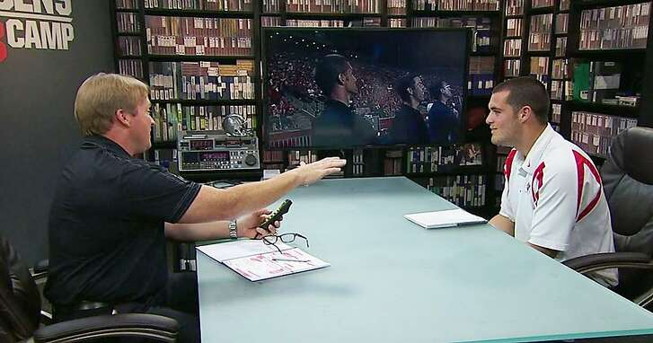"""Former Oakland Raiders coach Job Gruden (left) interviewed Fresno State Quarterback Derek Carr (right) ahead of the 2014 NFL Draft for """"Gruden QB Camp"""" segment on ESPN. Jon Gruden has been hired as the Raiders Head Coach and will be working closely with Raiders starting QB Derek Carr."""