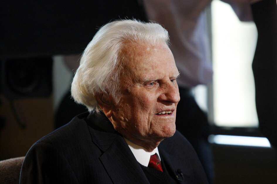 FILE- In this Dec. 20, 2010 file photo, evangelist Billy Graham, 92, is interviewed at the Billy Graham Evangelistic Association headquarters in Charlotte, N.C. The Rev. Billy Graham was admitted to a hospital Wednesday, Nov. 30, 2011 near his home in western North Carolina to be tested for pneumonia after suffering from congestion, a cough and a slight fever, his spokesman said. (AP Photo/Nell Redmond, File)