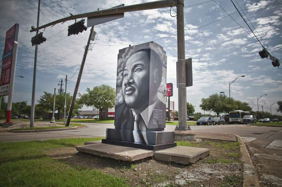 W3R3ON3 painted this mini-mural in honor of Dr. Martin Luther King at the corner of West Fuqua and White Heather Dr. Photo: Alex Barber, Up Art Studio