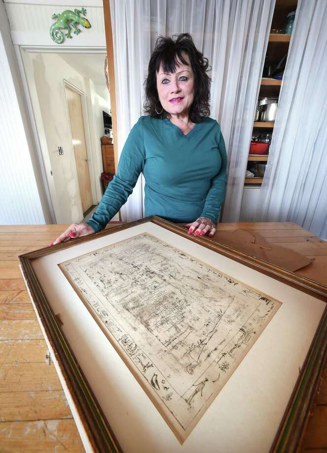 "Cheryl Conroy Warren is photographed at her home in Milford with a signed etching , ""Flaura and Fauna,"" by Chinese artist Zao Wou-Ki . Photo: Arnold Gold / Hearst Connecticut Media / New Haven Register"