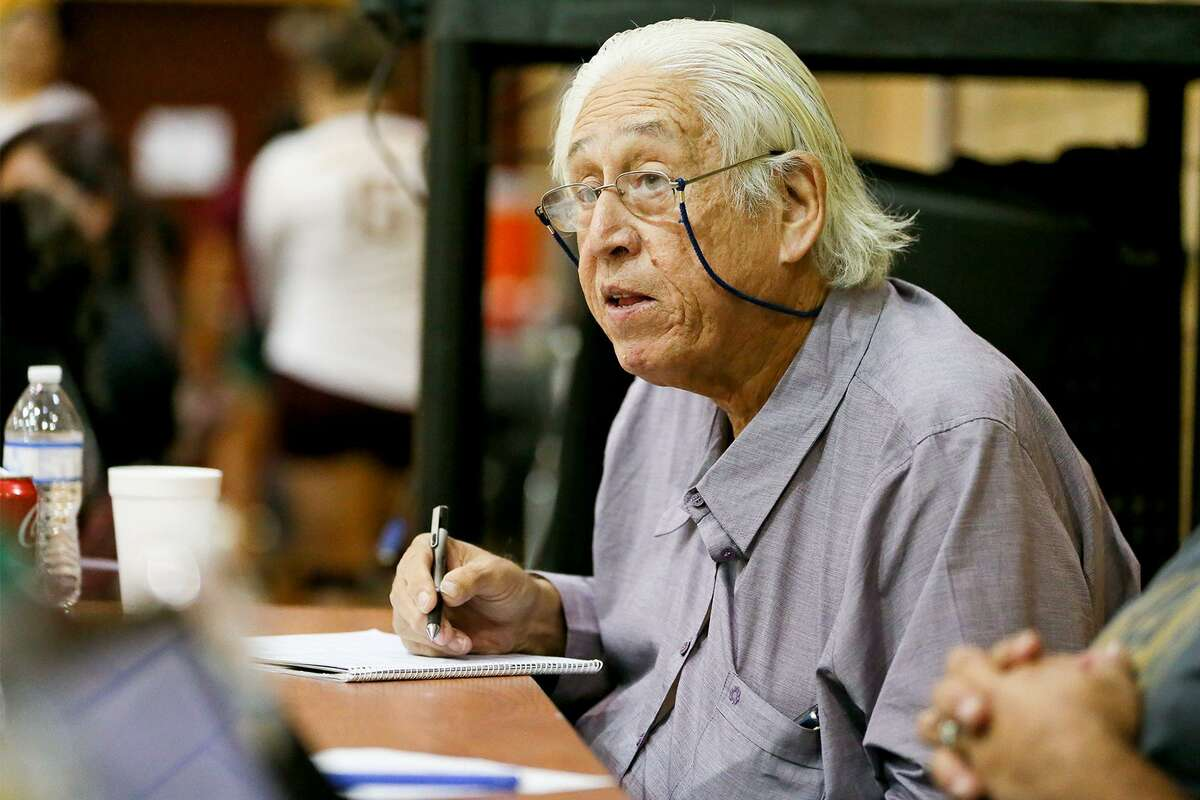Al Porter keeps score, something he's been doing since 1989, during the District 29-5A volleyball game between Harlandale and Floresville in October.