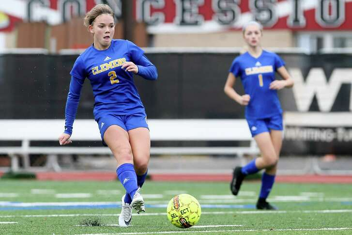 Clemens' Kelsey Ayers scores her second goal of the game as Madison Shaw trails behind her during the first half of their game with Southwest in the NEISD Girls Varsity Soccer Tournament at Comalander Stadium on Saturday, Jan. 20, 2018.  Clemens beat Southwest 8-1.  MARVIN PFEIFFER/mpfeiffer@express-news.net