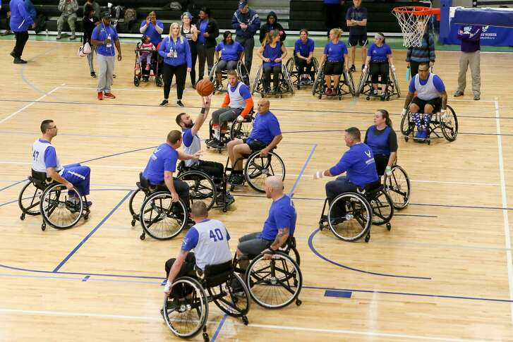 Teams compete in a wheelchair basketball game in a Warrior CARE event at Joint Base San Antonio-Randolph on Friday, Jan 12, 2018.  The event, run by the Air Force Personnel center, included wheelcahir basketball, sitting volleyball, swimming, air pistol and rifle shooting, archery, cycling and trank and field competitions including shot put, discus and running events.  MARVIN PFEIFFER/mpfeiffer@express-news.net