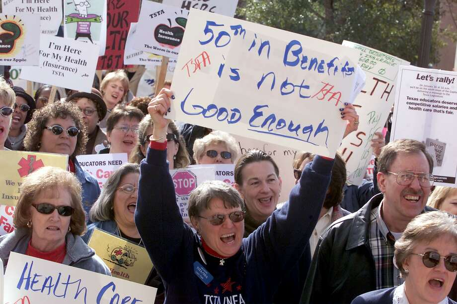Benefits for teachers, retired or not, has long been an issue in Texas. Add now concerns about a pension plan that is underfunded. Here, educators a rally at the Capitol in Austin in 2001 to ask for state paid health benefits for public school employess. Photo: DEBORAH CANNON /AP / AP