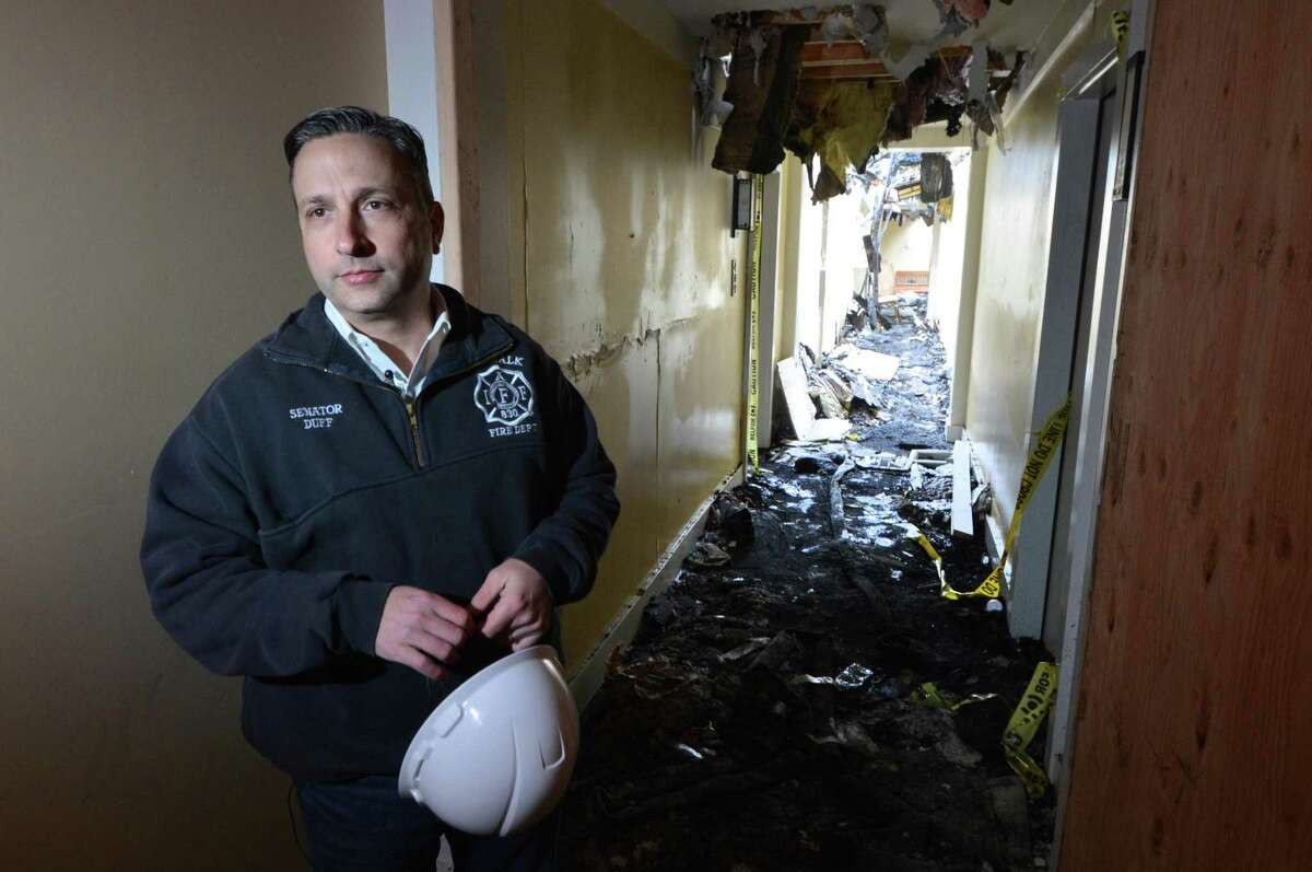 Senator Bob Duff takes a tour of the Stonewood Condominium complex that was heavily damaged by fire on Dec. 11th with personnel from Imagineers LLC and gets a close look at the interior and the 4th floor hallway on Monday january 22, 2018 in Norwalk Conn.