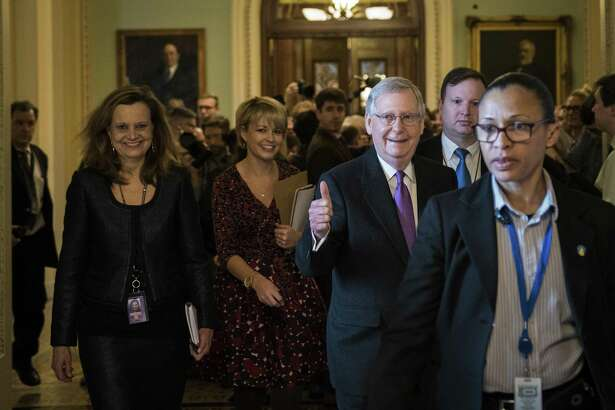 Senate Majority Leader Mitch McConnell (R-KY) gives the thumbs up after the Senate passed a procedural vote for a continuing resolution to fund the federal government, Capitol Hill, January 22, 2018 in Washington, DC. Lawmakers are continuing to seek a deal to end the government shutdown, now in day three.