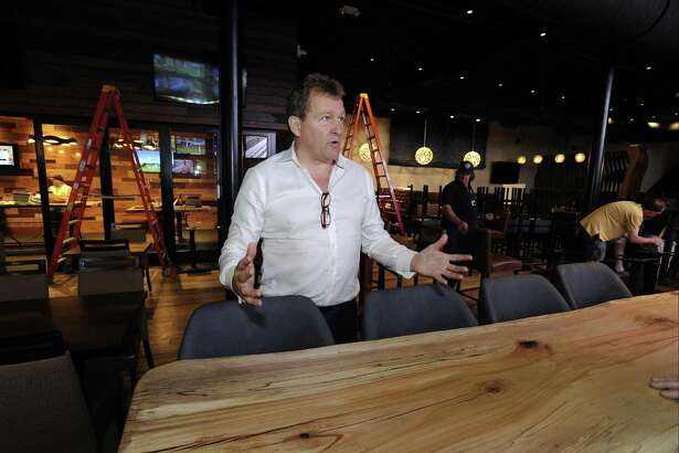 Ted Taylor, President of Sportech Venues, at the new Bobby V's, a sports bar, restaurant, and OTB lounge in Stamford. He said Sportech is well suited to offer sports betting.