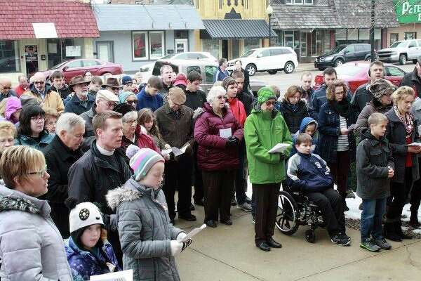Acrowd of more than 200 people gather on the steps of the Huron County Courthouse building Sunday afternoon for the annual Huron County Right to Life Memorial Service. (Rich Harp/For the Tribune)