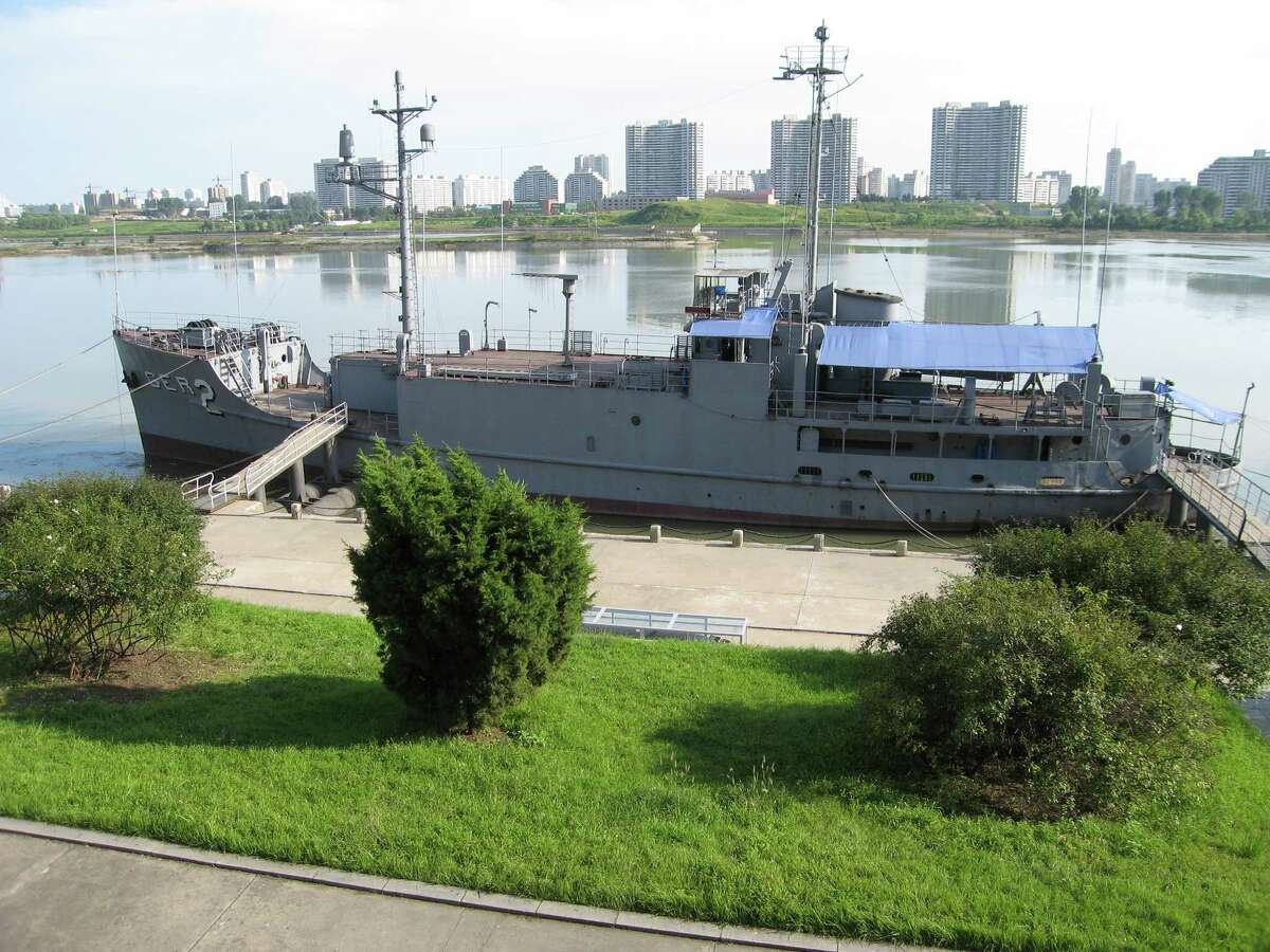 The USS Pueblo, a spy ship seized by North Korea in 1968, is now docked along the Taedong River in Pyongyang, the nation's capital, August 31, 2007. (Tim Johnson/MCT)