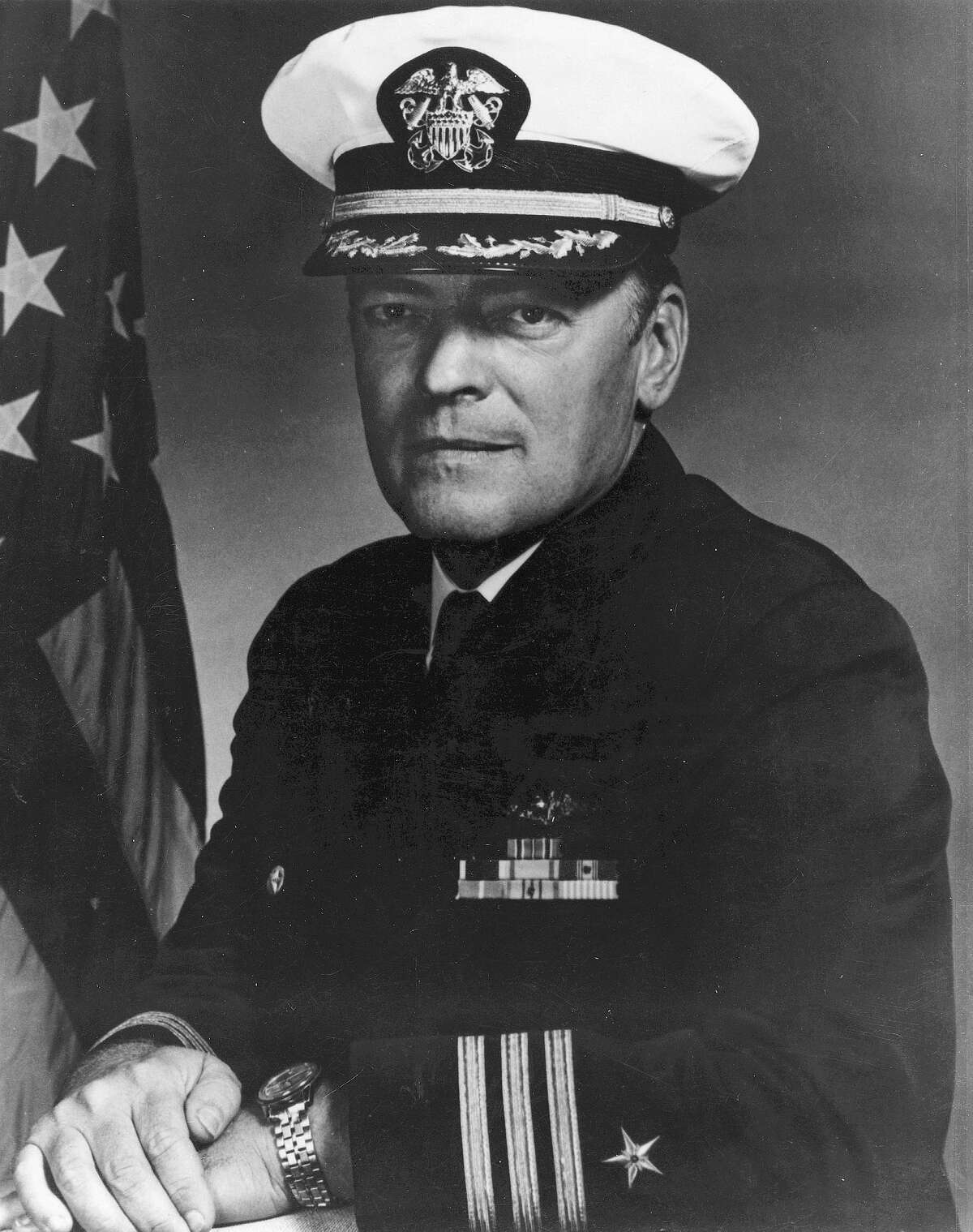 """Lloyd """"Pete"""" Bucher, the former Navy commander of the U.S. Navy intelligence ship USS Pueblo, shown in this 1967 file photo, died Wednesday, Jan. 28, 2004, in a nursing facility in Poway, Calif. He was 76. The infamous spy ship sparked an international crisis when its crew was taken hostage in 1968 by North Korea. (AP Photo/Girls and BoysTown)"""