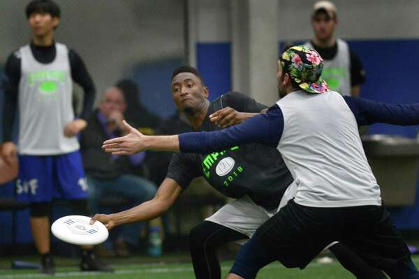 Frisbee players from the tri-state area including Marques Brownlee, center, try out for New York Empire, a professional ultimate team that has gone to the semi-finals twice in four seasons, January 20, 2018, in the SoNo Field house in Norwalk, Conn.