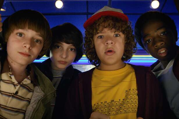 "This image released by Netflix shows Noah Schnapp, from left, Finn Wolfhard, Gaten Matarazzo and Caleb Mclaughlin in a scene from ""Stranger Things,"" premiering its second season on Friday. (Netflix via AP)"