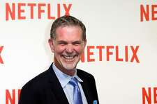 FILE - In this Sept. 15, 2014, file photo, Netflix CEO Reed Hastings arrives for the 'Netflix' Launch Party in Paris. Hastings made the surprise announcement at the end of a presentation Wednesday, Jan. 6, 2016, in Las Vegas at CES, a showcase for gadgets and technology services. Netflix has begun streaming its Internet video service in 130 more countries, nearly completing its expansion a year ahead of schedule. (AP Photo/Jacques Brinon, File)