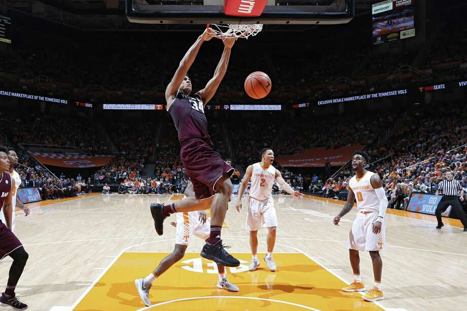 KNOXVILLE, TN - JANUARY 13: Tyler Davis #34 of the Texas A&M Aggies dunks against the Tennessee Volunteers in the first half of a game at Thompson-Boling Arena on January 13, 2018 in Knoxville, Tennessee. Tennessee won 75-62. (Photo by Joe Robbins/Getty Images) Photo: Joe Robbins, Stringer / Getty Images / 2018 Getty Images