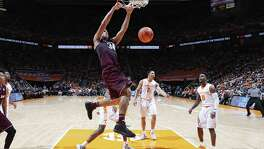 KNOXVILLE, TN - JANUARY 13: Tyler Davis #34 of the Texas A&M Aggies dunks against the Tennessee Volunteers in the first half of a game at Thompson-Boling Arena on January 13, 2018 in Knoxville, Tennessee. Tennessee won 75-62. (Photo by Joe Robbins/Getty Images)