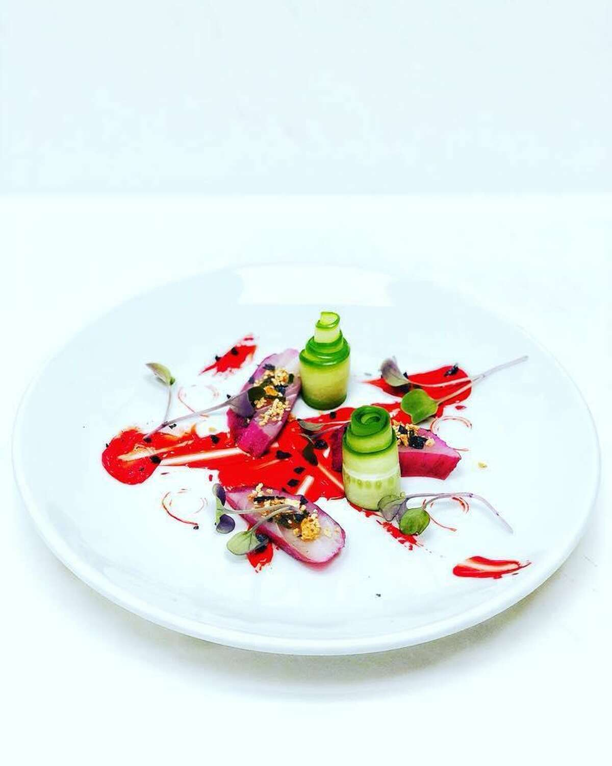 Dishes like this plate of sashimi with pickled fresno chiles and cucumber will make appearances as specials at Folklores.