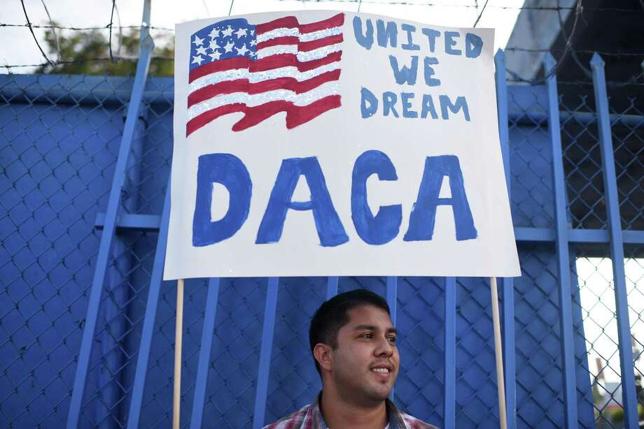 (FILES) This file photo taken on September 10, 2017 shows DACA recipient and appliance repair business owner Erick Marquez during a protest in support of DACA (Deferred Action for Childhood Arrivals) in Los Angeles, California.