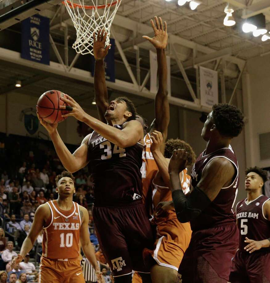 Texas A&M Aggies center Tyler Davis (34) goes up for a shot defended by Texas Longhorns forward Mohamed Bamba (4) in the second half during the exhibition basketball game between the Texas Longhorns and the Texas A&M Aggies to benefit the Rebuild Texas Relief Fund at Tudor Fieldhouse in Houston, TX on Wednesday, October 25, 2017. Photo: Tim Warner, Freelance / Houston Chronicle