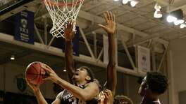 Texas A&M Aggies center Tyler Davis (34) goes up for a shot defended by Texas Longhorns forward Mohamed Bamba (4) in the second half during the exhibition basketball game between the Texas Longhorns and the Texas A&M Aggies to benefit the Rebuild Texas Relief Fund at Tudor Fieldhouse in Houston, TX on Wednesday, October 25, 2017.