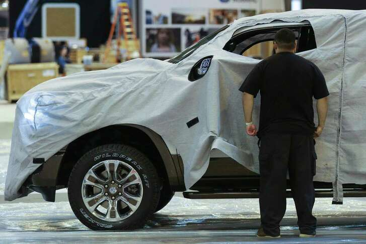 A new Ram truck, which will be unveiled Tuesday night, moves onto the show floor during set up for the Houston Auto Show at NRG Center Monday, Jan. 22, 2018 in Houston. ( Michael Ciaglo / Houston Chronicle)