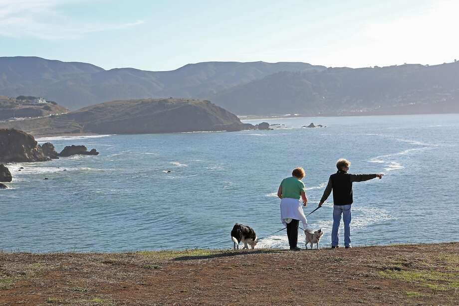 On November 3, 2012 in Pacifica, Calif. visitors enjoy the spectacular views from Mori Point's bluff, which on a clear day can offer stunning ocean views north to Point Reyes, south to Pedro Point and west to the Farallon Islands in the Pacific. Photo: Rashad Sisemore, The Chronicle