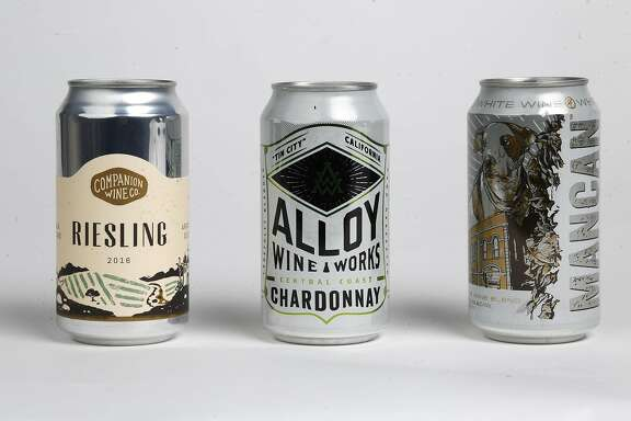 Wines in a can, as seen on Tuesday, Jan. 16, 2018 in San Francisco Studio, Calif. Companion Wine Co. 2016 Riesling, Alloy Wine Works Central Coast Chardonnay and Mancan White Wine blend.