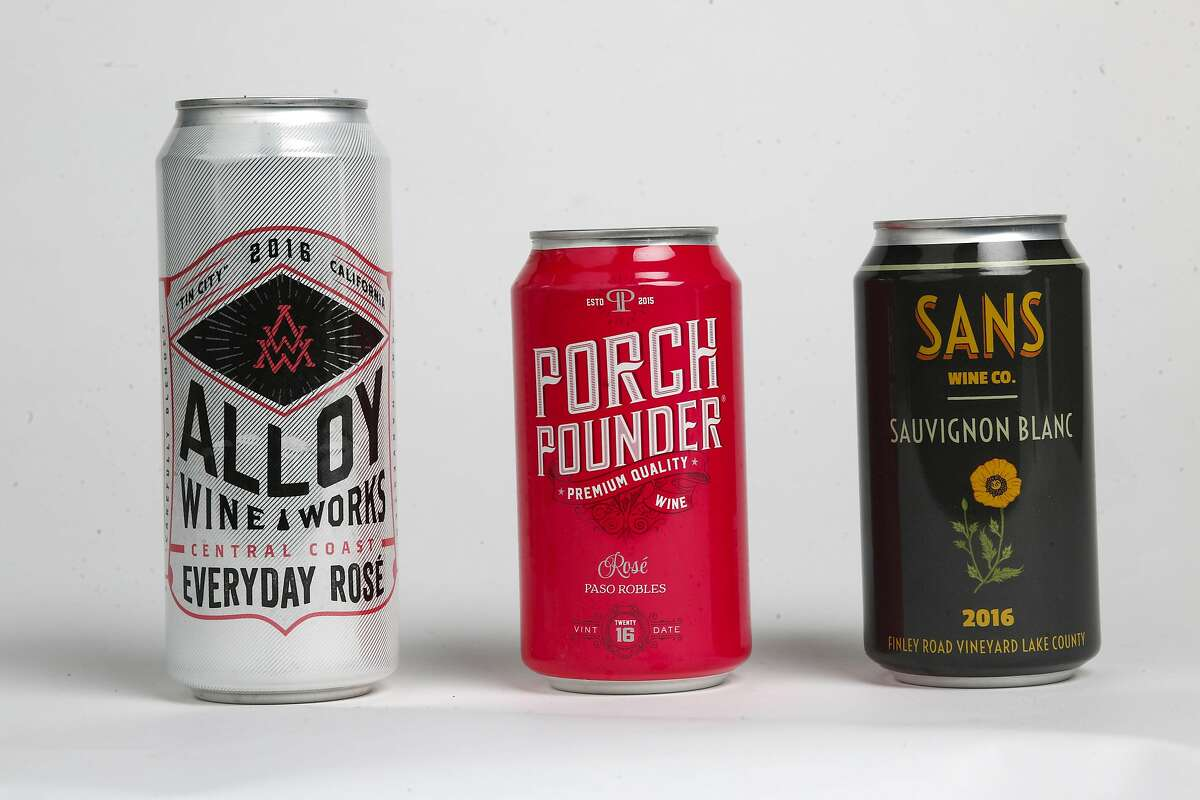 Wines in a can, as seen on Tuesday, Jan. 16, 2018 in San Francisco Studio, Calif. Alloy Wine Works Centra Coast Everyday Rose, Porch Pounder Wine Rose and Sans Wine Co. Sauvignon Blanc.
