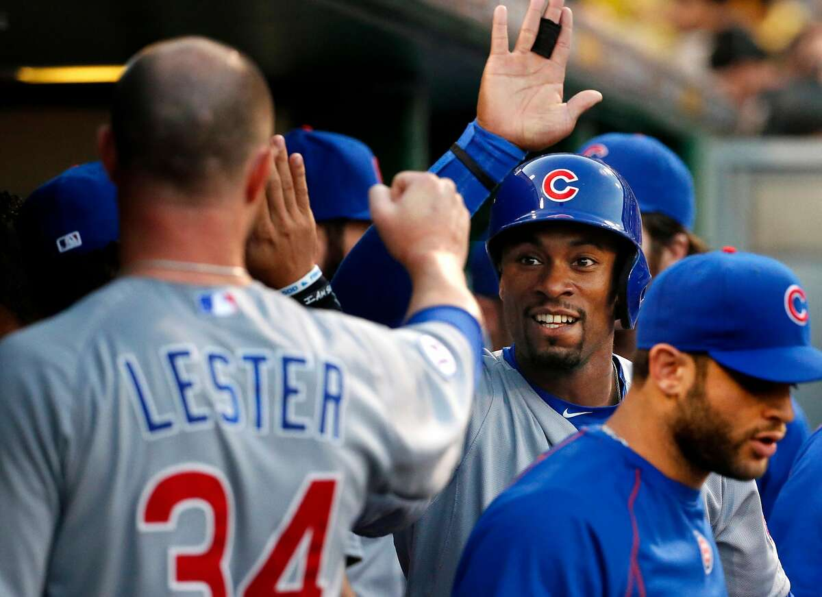 FILE - In this Tuesday, Sept. 15, 2015 file photo, Chicago Cubs' Austin Jackson, second right, celebrates with pitcher Jon Lester after scoring during the first inning of the second baseball game of a doubleheader against the Pittsburgh Pirates in Pittsburgh. The Chicago White Sox bolstered their outfield depth when free agent Austin Jackson agreed to a $5 million, one-year contract on Sunday, March 6, 2016. (AP Photo/Gene J. Puskar, File)