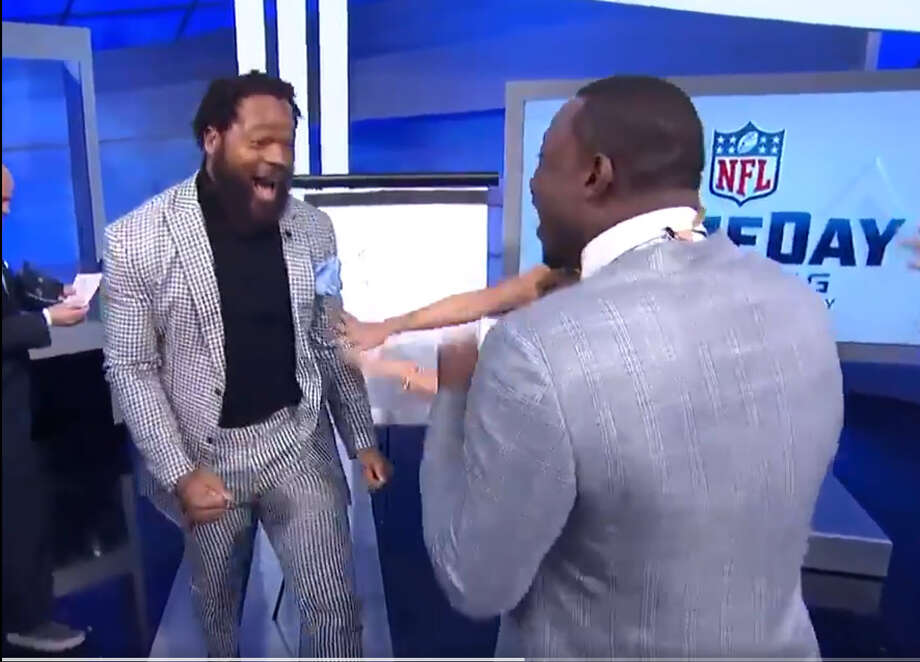 Michael Bennett celebrates during a game of Pictionary on NFL Network's GameDay morning show Sunday, Jan. 21. Photo: NFL NETWORK
