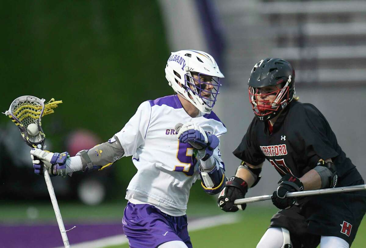 UAlbany's Connor Fields (5) moves the ball against Hartford's Chris Duffy (17) during a NCAA Division I college men's lacrosse game on Saturday, April 29, 2017, in Albany, N.Y. (Hans Pennink / Special to the Times Union) ORG XMIT: HP111