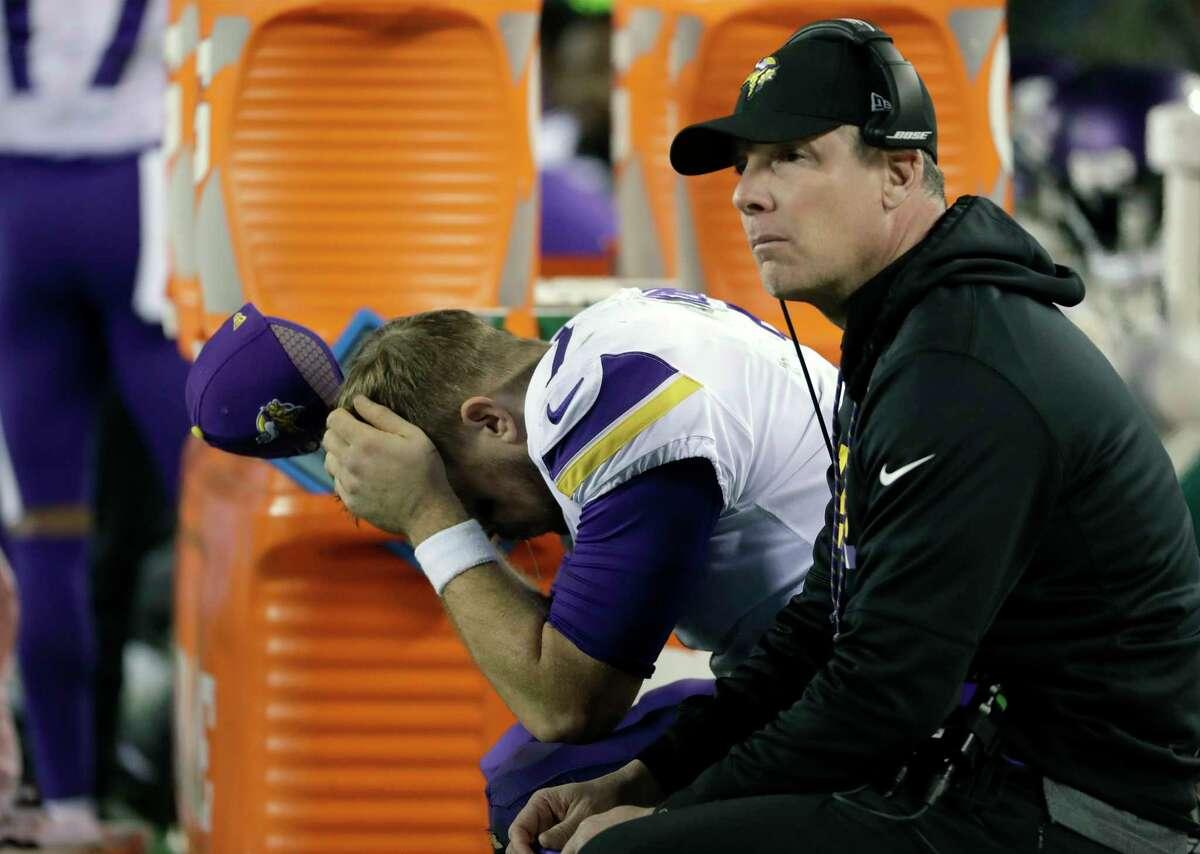 Minnesota Vikings quarterback Case Keenum, left, reacts on the bench beside offensive coordinator Pat Shurmur during the second half of the NFL football NFC championship game against the Philadelphia Eagles, in Philadelphia. (AP Photo/Matt Slocum)