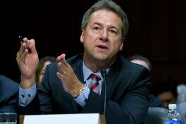 FILE - In this Sept. 7, 2017 file photo, Montana Governor Steve Bullock speaks before a U.S. Senate committee Capitol Hill in Washington. The Democrat signed an executive order Monday prohibiting telecommunications companies from receiving state contracts if they interfere with internet traffic or favor higher-paying sites or apps. ( AP Photo/Jose Luis Magana, File )