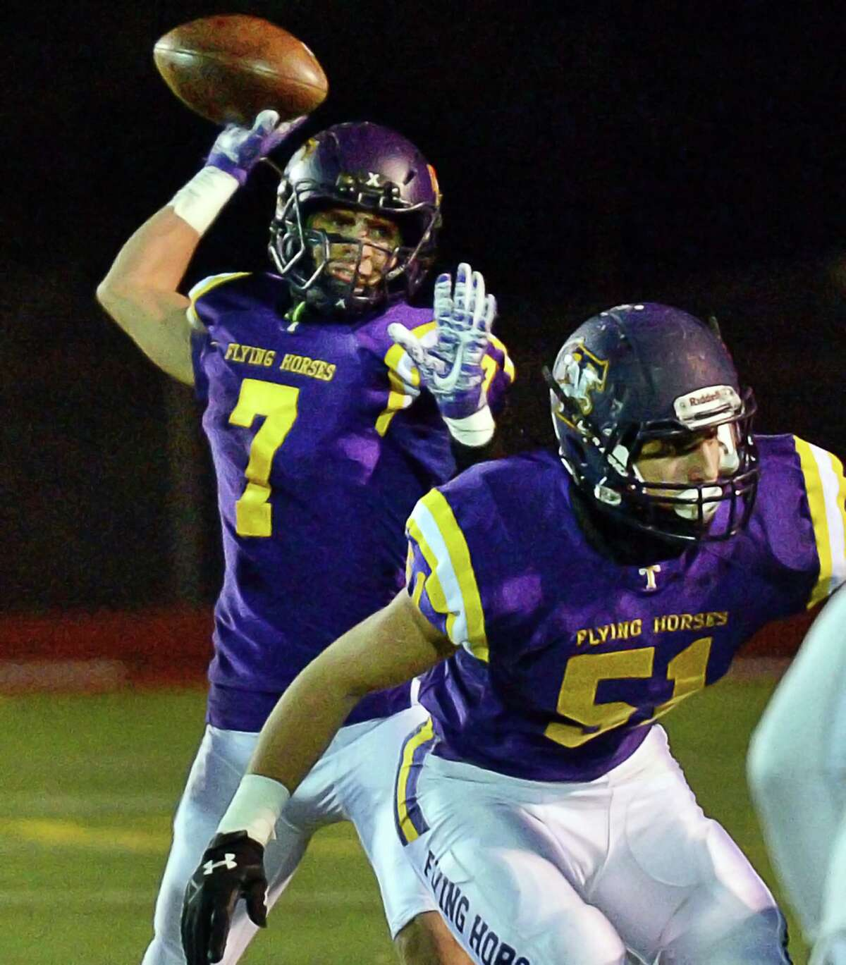 Troy QB #7 Joe Casale, left, gets off a pass as #51Derrick Cipriani provides protection during their Class AA quarterfinal game against New Rochelle Friday Nov. 10, 2017 in East Greenbush, NY. (John Carl D'Annibale / Times Union)