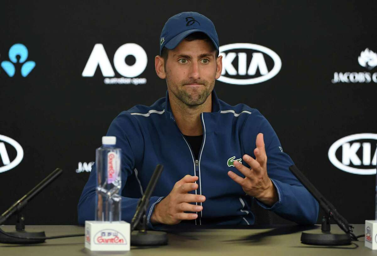 Serbia's Novak Djokovic speaks during a press conference after his loss to South Korea's Hyeon Chung in their men's singles fourth round match on day eight of the Australian Open tennis tournament in Melbourne on January 22, 2018. / AFP PHOTO / WILLIAM WEST / -- IMAGE RESTRICTED TO EDITORIAL USE - STRICTLY NO COMMERCIAL USE --WILLIAM WEST/AFP/Getty Images
